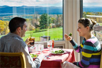 A couple eating near the windows at the Hilltop Restaurant