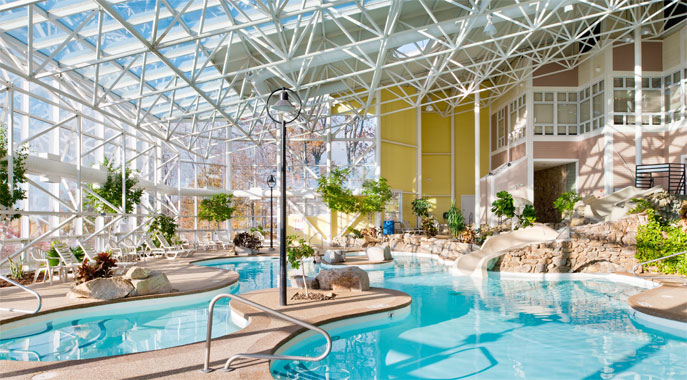 The large indoor pool area and waterslide at Steele Hill West