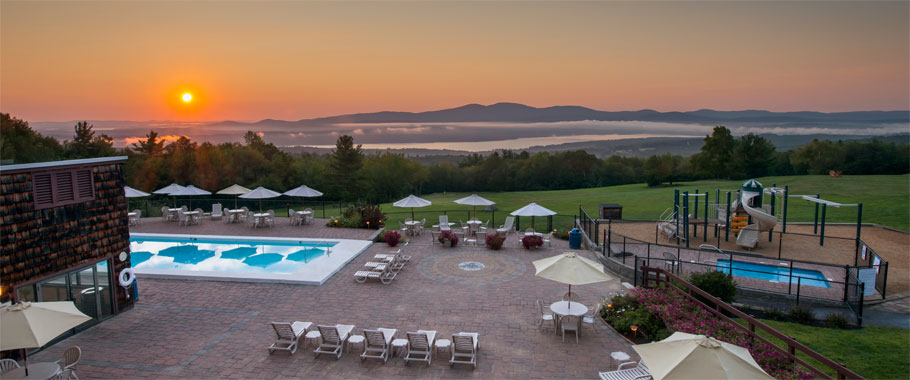 Experience the most breathtaking sunrises in New Hampshire overlooking Lake Winnisquam and the Belknap Mountains