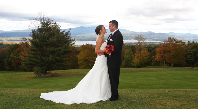 A wedding couple embraces during the foliage season at Steele Hill