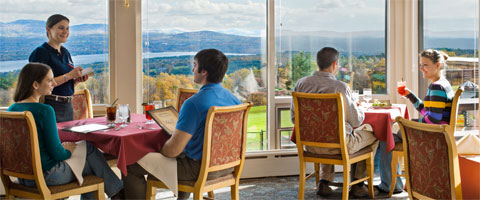 Couples dining infront of the picture windows overlooking Lake Winnisquam at the Hilltop Restaurant