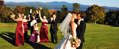 A wedding kiss with a backdrop of lakes and mountains.